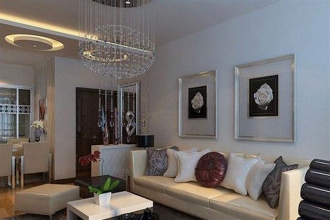 在装饰柜中整齐的摆放着小饰品,让小户型的客厅充满了清新的味道.